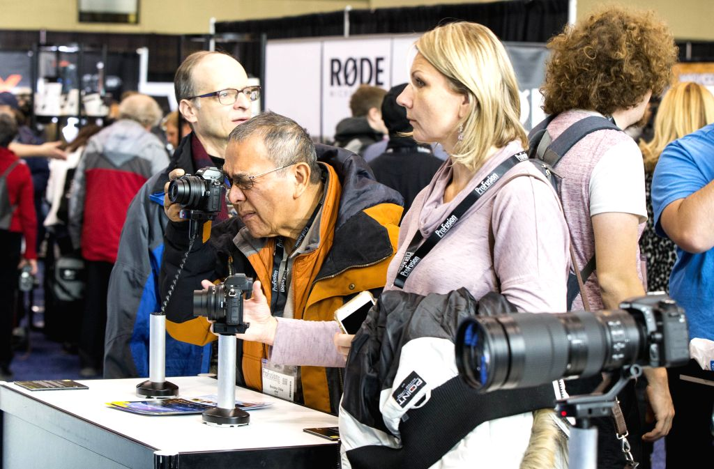 TORONTO, Nov. 13, 2019 - A man takes test shoots with a Nikon Z50 camera during the 2019 ProFusion Expo in Toronto, Canada, Nov. 13, 2019. As the largest professional broadcast video and photo expo ...