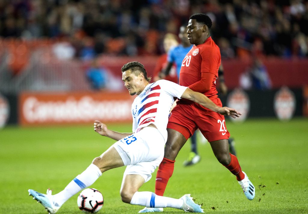 TORONTO, Oct. 16, 2019 - Jonathan David (R) of Canada vies with Aaron Long of the United States during their League A Group A match of the 2019-2020 Concacaf Nations League at BMO Field in Toronto, ...
