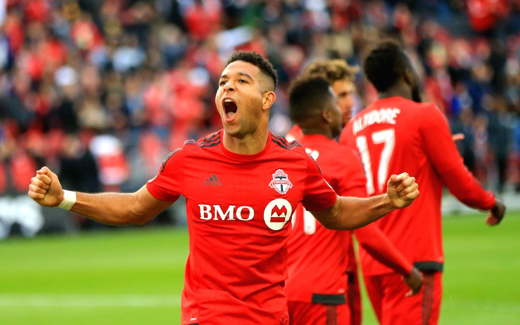TORONTO, Oct. 24, 2016 - Justin Morrow (Front) of Toronto FC celebrates after scoring in the 2016 Major League Soccer match between Toronto FC and Chicago Fire in Toronto, Canada, Oct. 23, 2016. ...