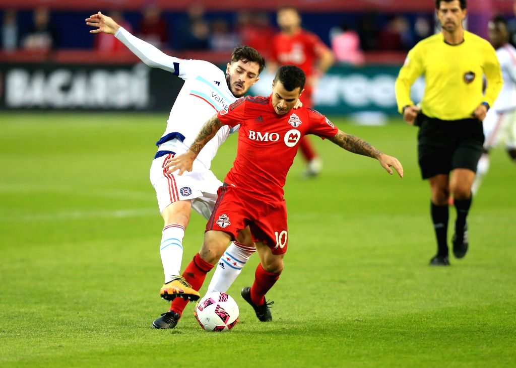 TORONTO, Oct. 24, 2016 - Sebastian Giovinco (2nd L) of Toronto FC vies with Razvan Cocis (1st L) of Chicago Fire during the 2016 Major League Soccer match between Toronto FC and Chicago Fire in ...