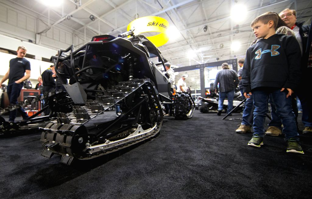 TORONTO, Oct. 25, 2019 - A boy looks at a Ski-doo all-terrain vehicle during the 2019 Toronto International Snowmobile, ATV & Powersports Show at Toronto International Center in Toronto, Canada, ...