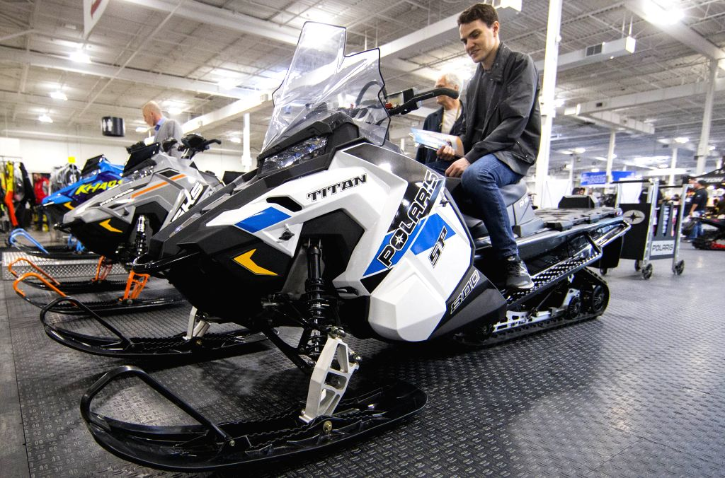TORONTO, Oct. 25, 2019 - A man tries a Polaris snowmobile during the 2019 Toronto International Snowmobile, ATV & Powersports Show at Toronto International Center in Toronto, Canada, on Oct. 25, ...