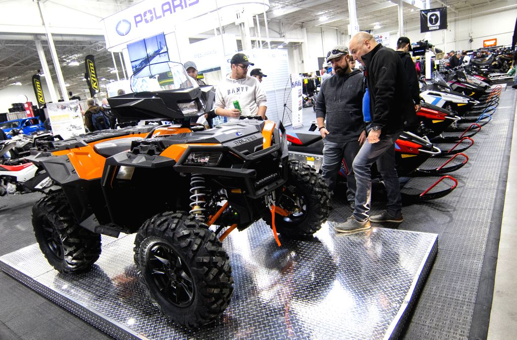 TORONTO, Oct. 25, 2019 - People look at a Polaris all-terrain vehicle during the 2019 Toronto International Snowmobile, ATV & Powersports Show at Toronto International Center in Toronto, Canada, ...