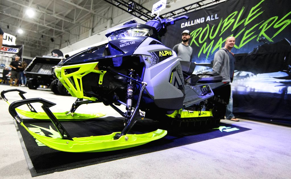 TORONTO, Oct. 25, 2019 - People walk past an Arctic Cat snowmobile during the 2019 Toronto International Snowmobile, ATV & Powersports Show at Toronto International Center in Toronto, Canada, on ...