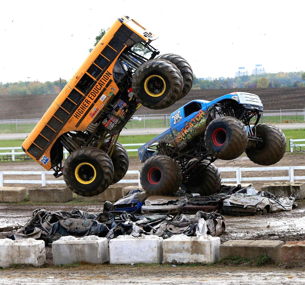 TORONTO, Oct. 3, 2016 - Two monster trucks perform during the Monster Truck Show at the Markham Fair Event in Markham, Ontario, Canada, Oct. 2, 2016.