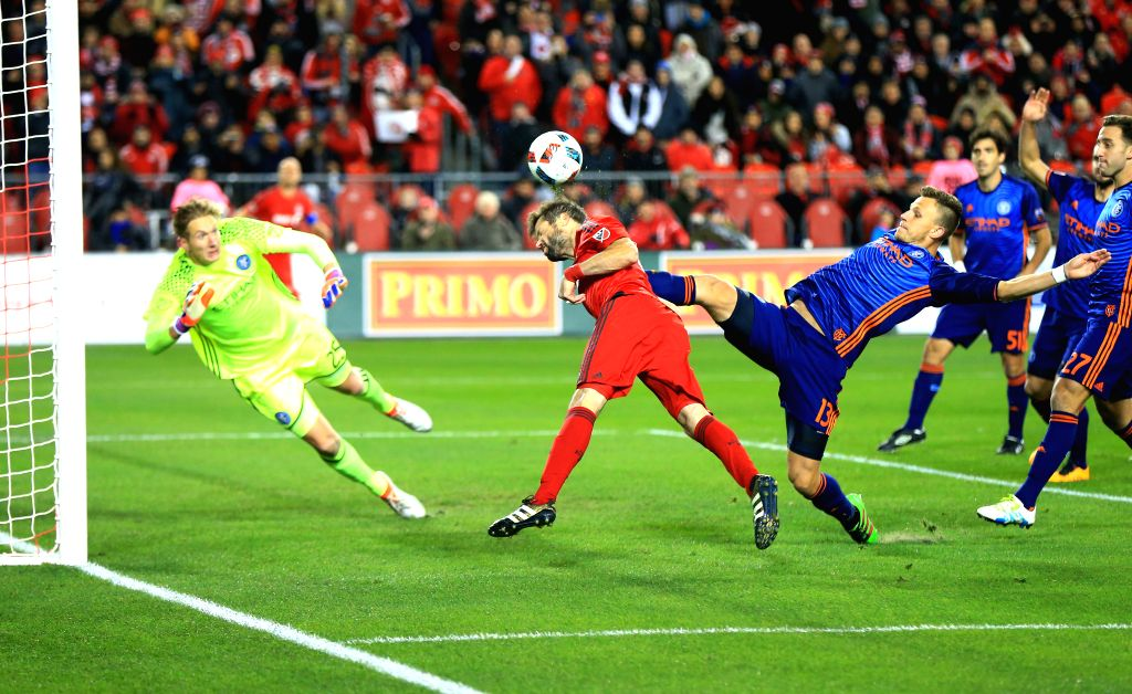 TORONTO, Oct. 31, 2016 - Drew Moor (2nd L) of Toronto FC vies with Frederic Brillant (3rd R) of New York City FC during their Eastern Conference Semifinals Leg-1 match of the 2016 Major League Soccer ...