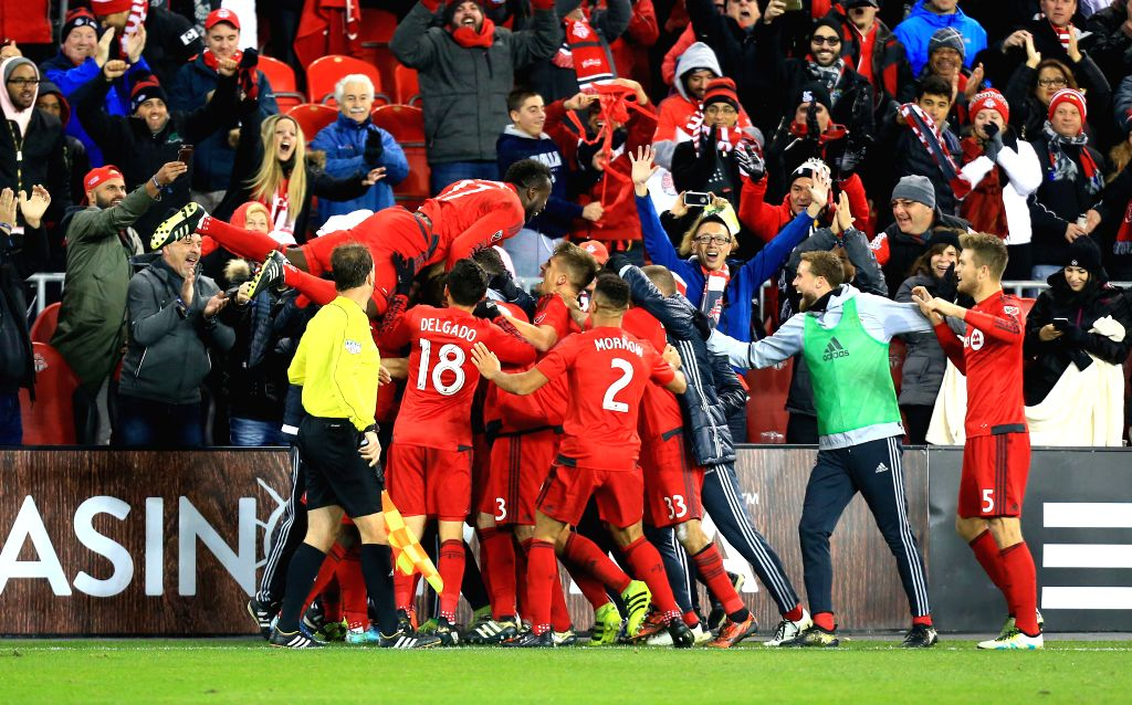 TORONTO, Oct. 31, 2016 - Players of Toronto FC celebrate scoring during the Eastern Conference Semifinals Leg-1 match of the 2016 Major League Soccer (MLS) against New York City FC in Toronto, ...