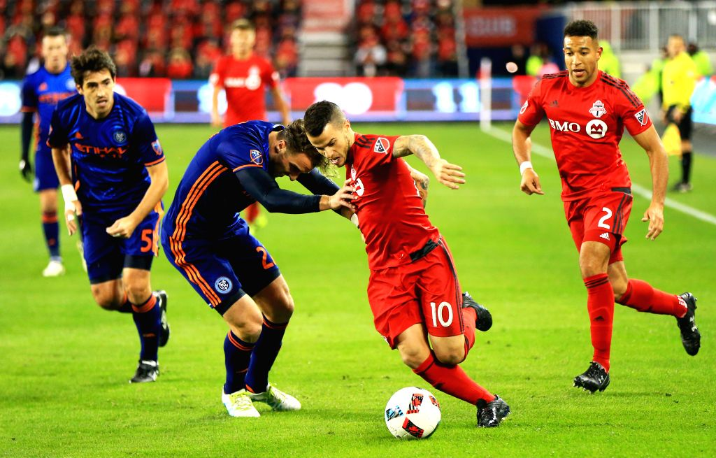 TORONTO, Oct. 31, 2016 - Sebastian Giovinco (2nd R) of Toronto FC vies with RJ Allen (3rd R) of New York City FC during their Eastern Conference Semifinals Leg-1 match of the 2016 Major League Soccer ...