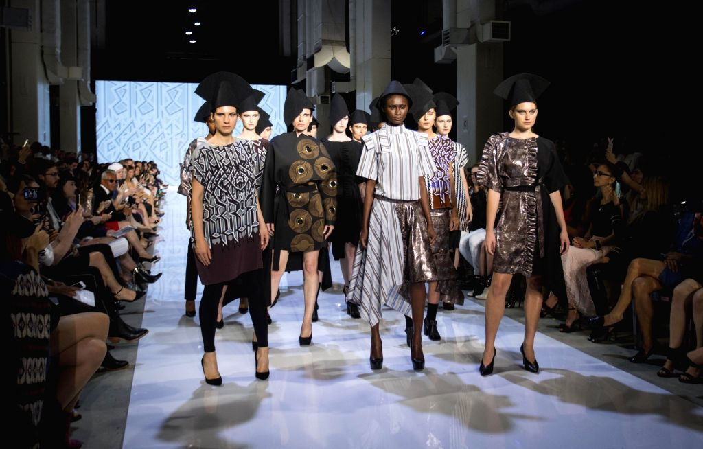 TORONTO, Oct. 5, 2017 - Models present creations of Zoran Dobric during the Spring/Summer 2018 Toronto Women's Fashion Week in Toronto, Canada, Oct. 4, 2017.