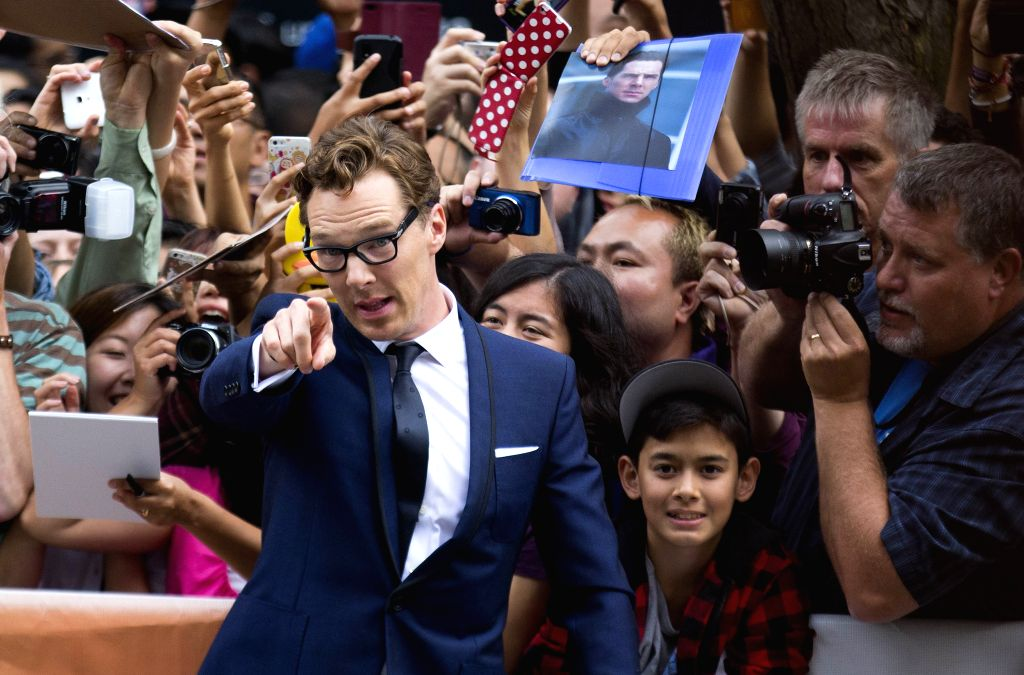 """Actor Benedict Cumberbatch (Front) poses for photos with fans before the Canadian premiere of the film """"The Imitation Game"""" at Princess of Wales Theater . - Benedict Cumberbatch"""