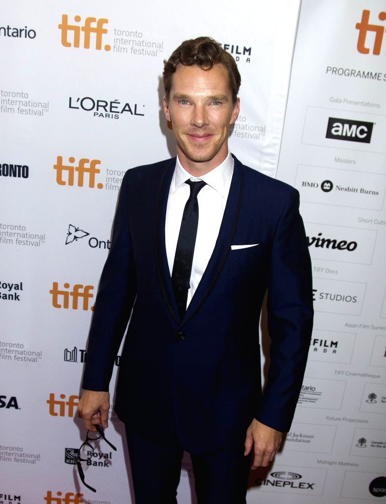 """Actor Benedict Cumberbatch poses for photos before the Canadian premiere of the film """"The Imitation Game"""" at Princess of Wales Theater during the 39th ... - Benedict Cumberbatch"""