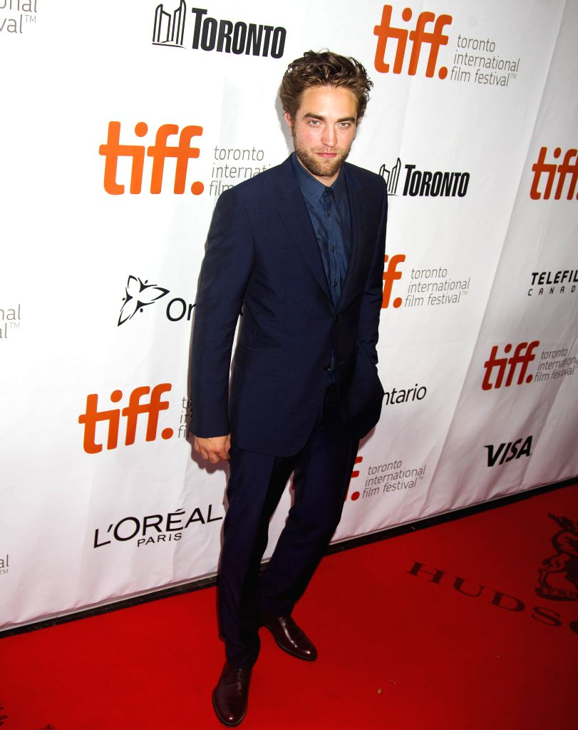 """Actor Robert Pattinson poses for photos before the North American premiere of the film """"Maps To The Stars"""" at Roy Thomson Hall during the 39th Toronto ... - Robert Pattinson"""