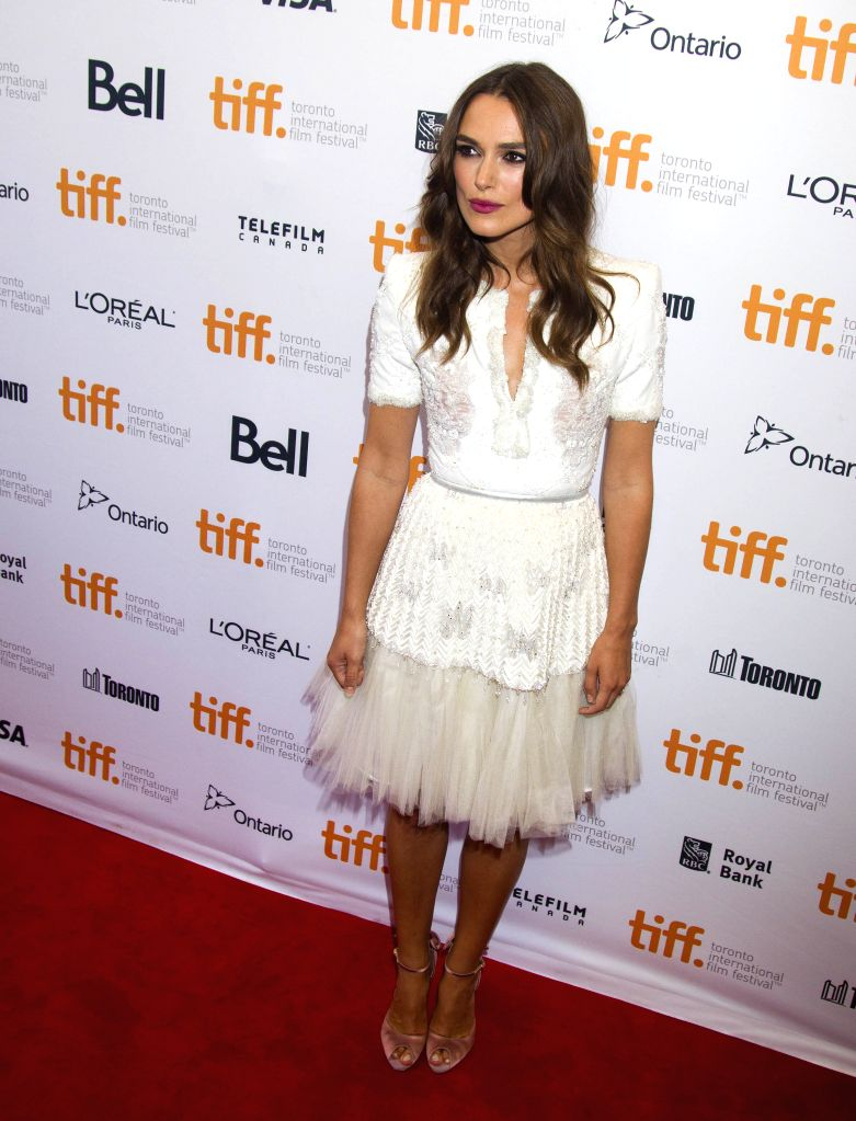 """Actress Keira Knightley poses for photos before the Canadian premiere of the film """"The Imitation Game"""" at Princess of Wales Theater during the 39th ... - Keira Knightley"""