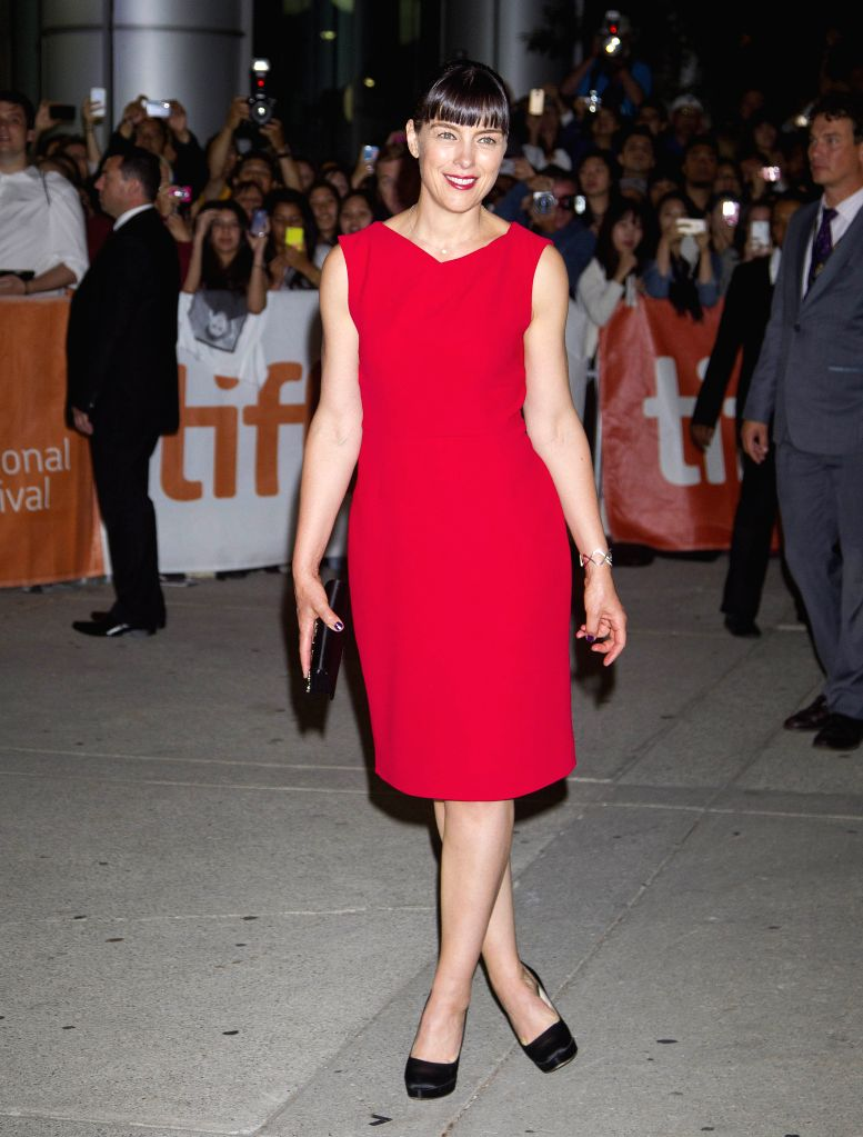 "Actress Olivia Williams poses for photos before the North American premiere of the film ""Maps To The Stars"" at Roy Thomson Hall during the 39th Toronto .. - Olivia Williams"