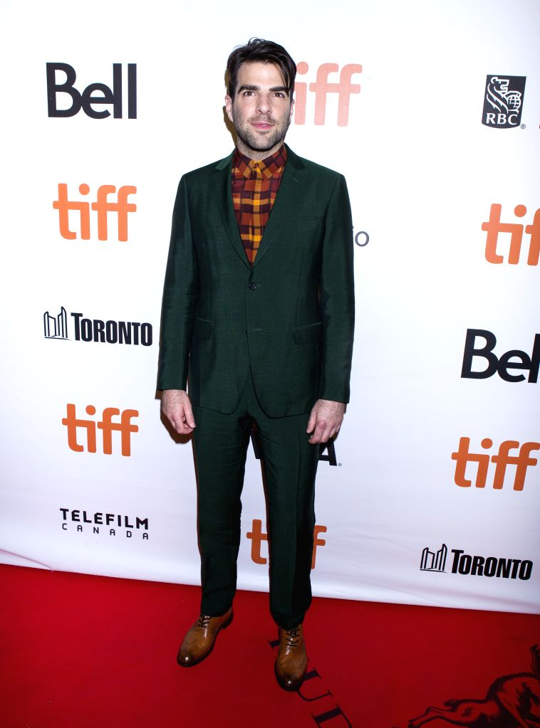 """TORONTO, Sept. 10, 2016 - Actor Zachary Quinto poses for photos before the world premiere of the film """"Snowden"""" at Roy Thomson Hall during the 41st Toronto International Film Festival in ... - Zachary Quinto"""