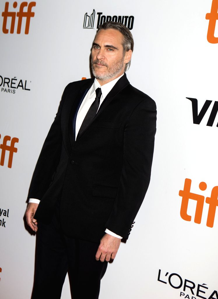 "TORONTO, Sept. 10, 2019 - Actor Joaquin Phoenix poses for photos before the North American premiere of the film ""Joker"" at Roy Thomson Hall during the 2019 Toronto International Film ... - Joaquin Phoenix"
