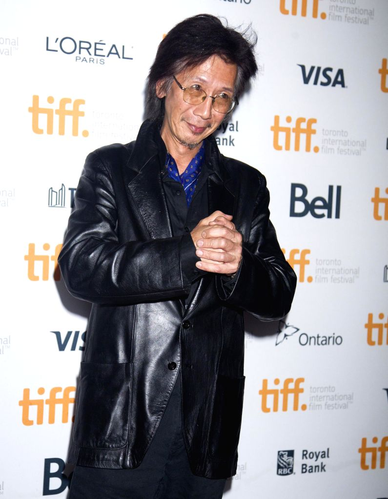 "Actor Geoff Lee poses for photos before the world premiere of the film ""Revenge of The Green Dragons"" at Ryerson Theater during the 39th Toronto ... - Geoff Lee"