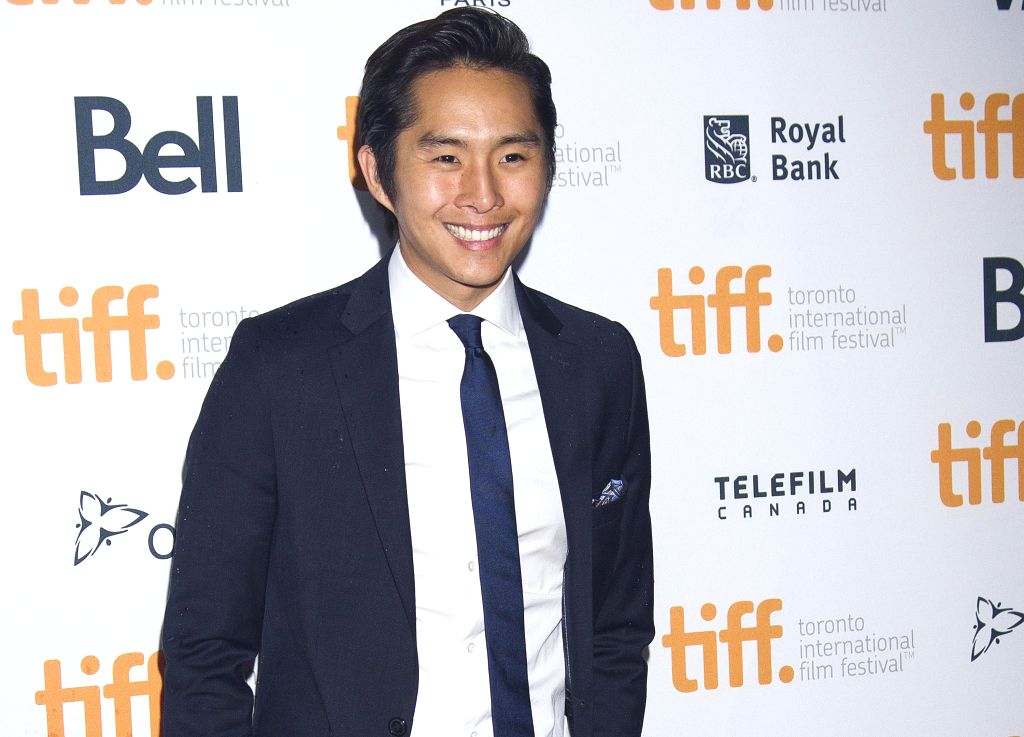 "Actor Justin Chon poses for photos before the world premiere of the film ""Revenge of The Green Dragons"" at Ryerson Theater during the 39th Toronto ... - Justin Chon"