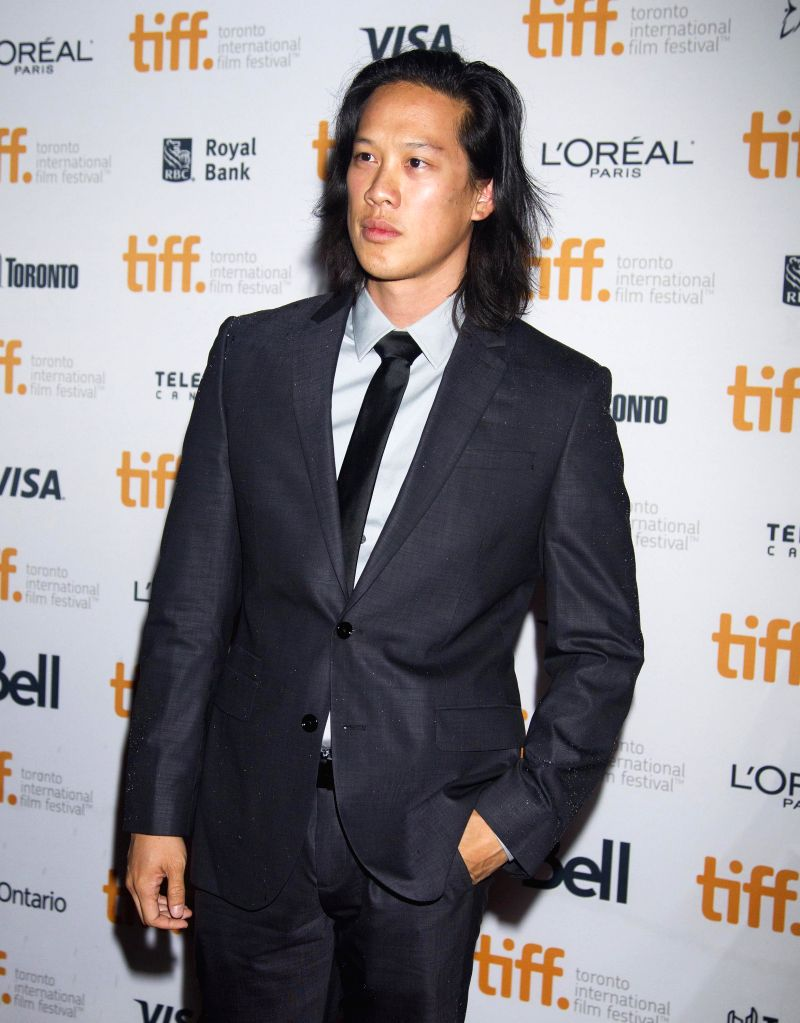 "Actor Leonard Wu poses for photos before the world premiere of the film ""Revenge of The Green Dragons"" at Ryerson Theater during the 39th Toronto ... - Leonard W"