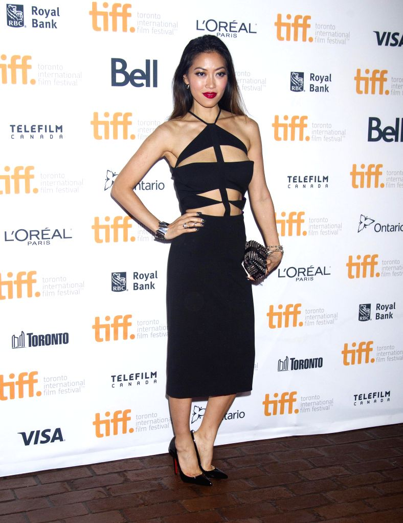 "Actress Devon Diep poses for photos before the world premiere of the film ""Revenge of The Green Dragons"" at Ryerson Theater during the 39th Toronto ... - Devon Diep"