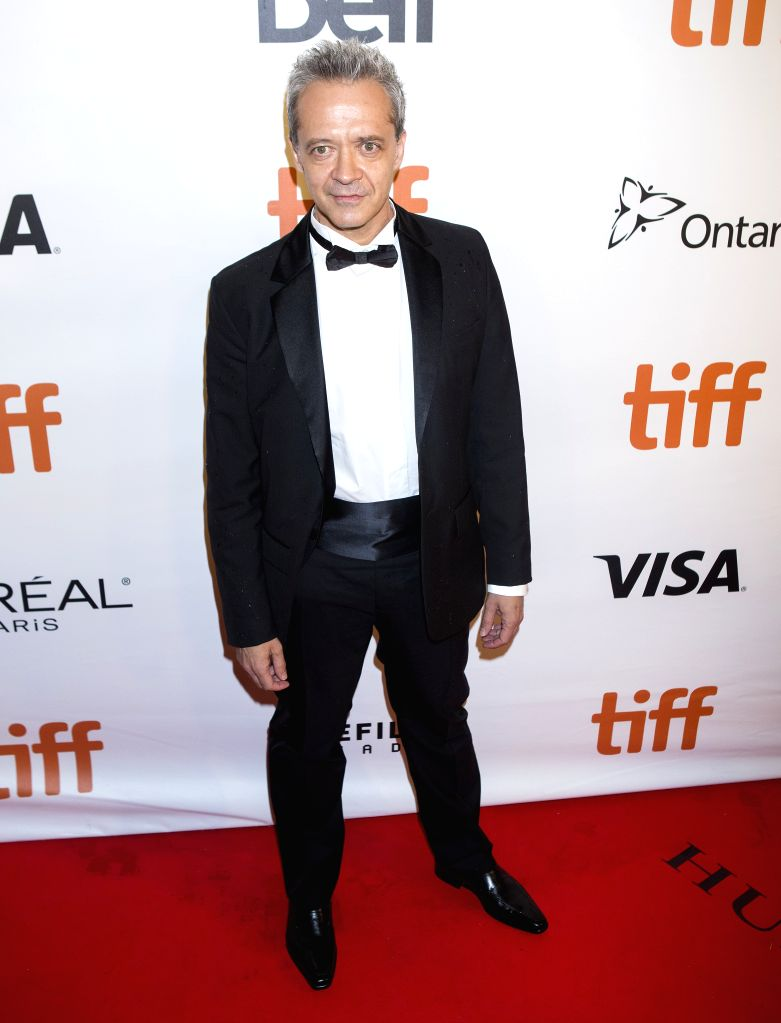 """TORONTO, Sept. 11, 2016 - Actor Emmanuel Salinger poses for photos before the North American premiere of the film """"Planetarium"""" at Roy Thomson Hall during the 41st Toronto International ... - Emmanuel Salinger"""