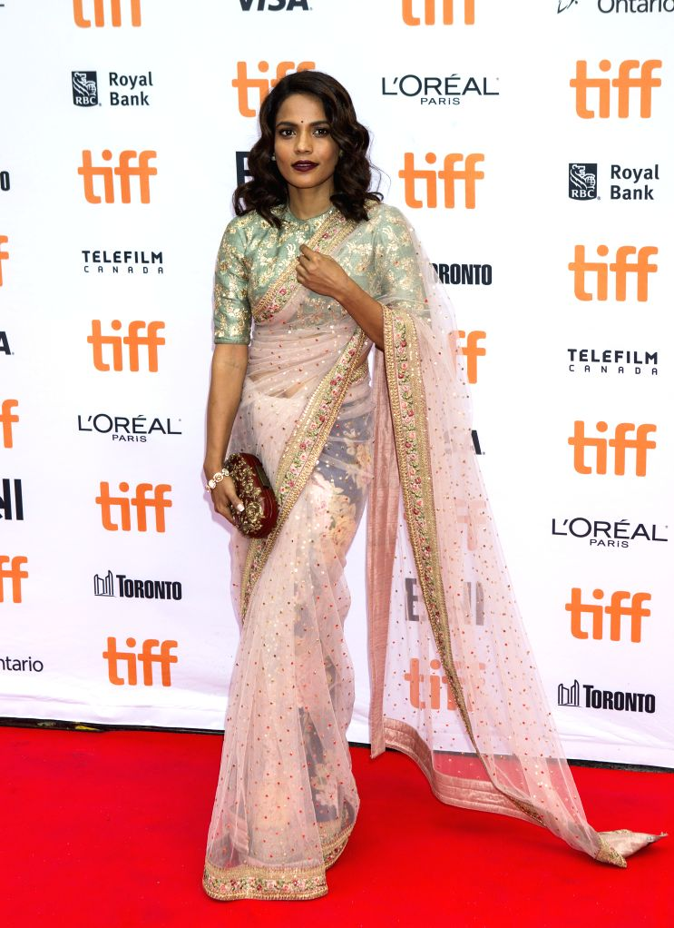 """TORONTO, Sept. 11, 2016 - Actress Priyanka Bose poses for photos before the world premiere of the film """"Lion"""" at Princess of Wales Theatre during the 41st Toronto International Film ... - Priyanka Bose"""
