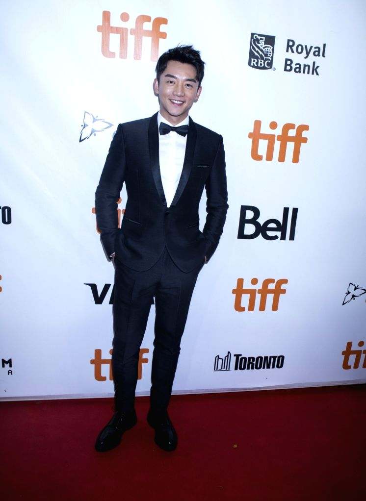 """TORONTO, Sept. 11, 2018 - Actor Zheng Kai poses for photos before the North American premiere of the film """"Shadow"""" at Roy Thomson Hall during the 2018 Toronto International Film Festival in ... - Zheng Kai"""