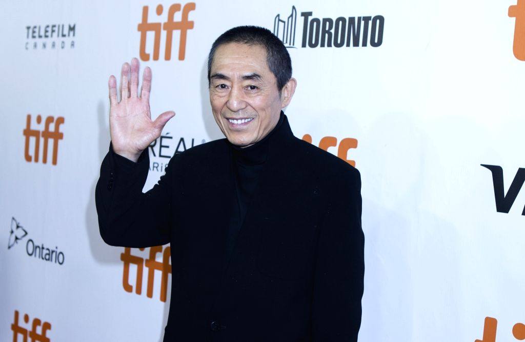 """TORONTO, Sept. 11, 2018 - Director Zhang Yimou poses for photos before the North American premiere of the film """"Shadow"""" at Roy Thomson Hall during the 2018 Toronto International Film ..."""