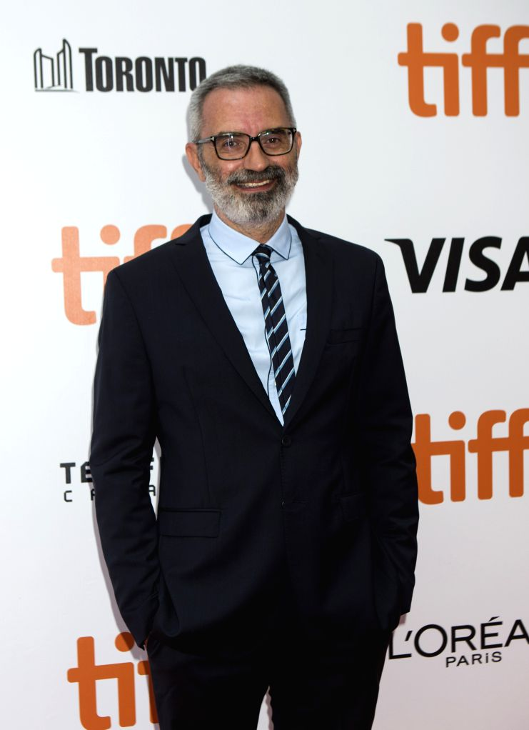 """TORONTO, Sept. 11, 2019 - Director Giuseppe Capotondi poses for photos before the North American premiere of the film """"The Burnt Orange Heresy"""" at Roy Thomson Hall during the 2019 Toronto ..."""