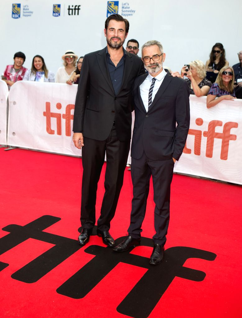 """TORONTO, Sept. 11, 2019 - Director Giuseppe Capotondi (R) and actor Claes Bang pose for photos before the North American premiere of the film """"The Burnt Orange Heresy"""" at Roy Thomson Hall ... - Claes Bang"""