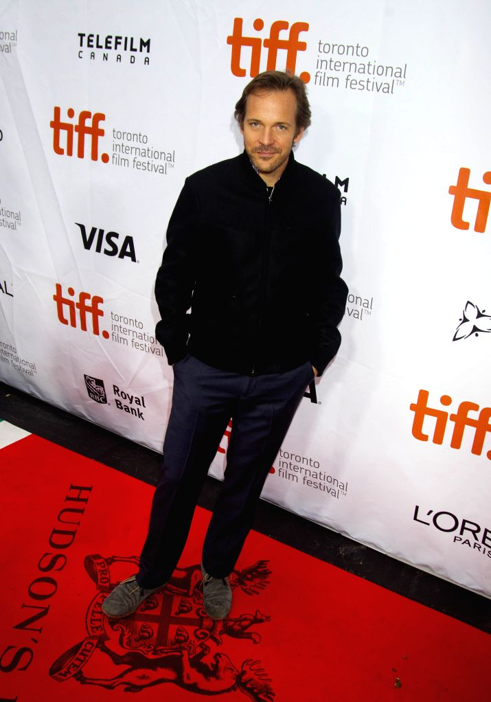 """Actor Peter Sarsgaard poses for photos before the world premiere of the film """"Pawn Sacrifice"""" at Roy Thomson Hall during the 39th Toronto International .. - Peter Sarsgaard"""