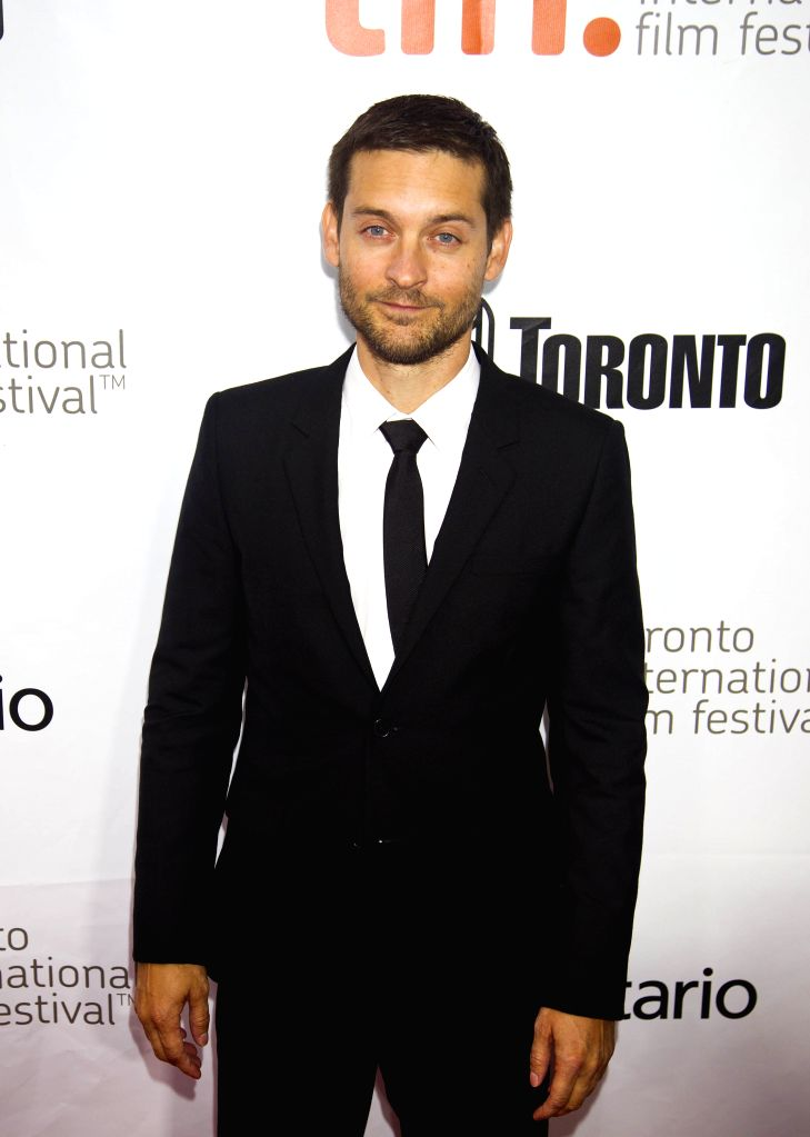 """Actor Tobey Maguire poses for photos before the world premiere of the film """"Pawn Sacrifice"""" at Roy Thomson Hall during the 39th Toronto International ... - Tobey Maguire"""