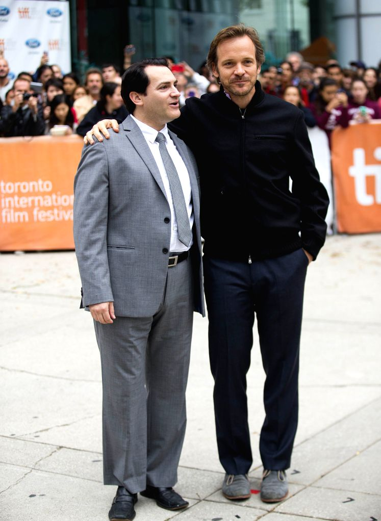 """Actors Michael Stuhlbarg (L) and Peter Sarsgaard pose for photos before the world premiere of the film """"Pawn Sacrifice"""" at Roy Thomson Hall during the ... - Michael Stuhlbarg"""