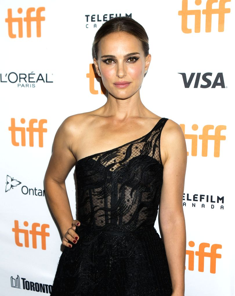 "TORONTO, Sept. 12, 2019 - Actress Natalie Portman poses for photos before the world premiere of the film ""Lucy in the Sky"" at Princess of Wales Theatre during the 2019 Toronto International ... - Natalie Portman"