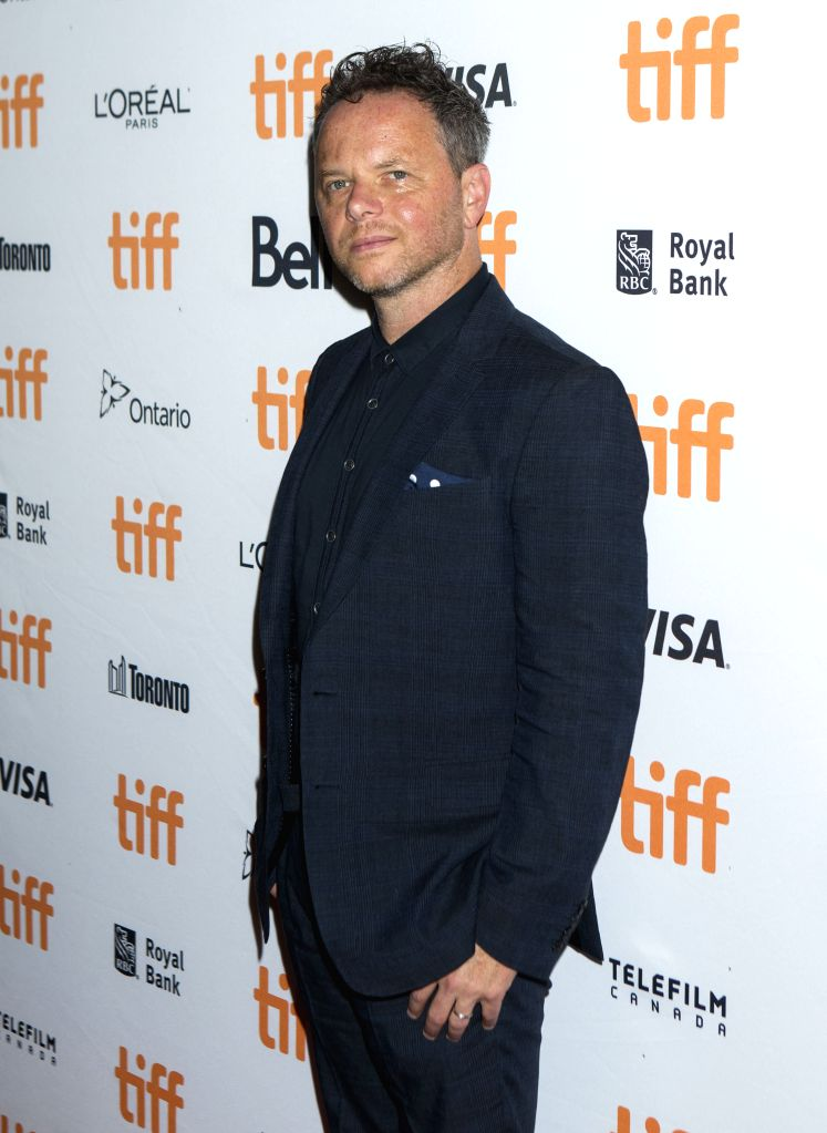 "TORONTO, Sept. 12, 2019 - Director Noah Hawley poses for photos before the world premiere of the film ""Lucy in the Sky"" at Princess of Wales Theatre during the 2019 Toronto International ..."