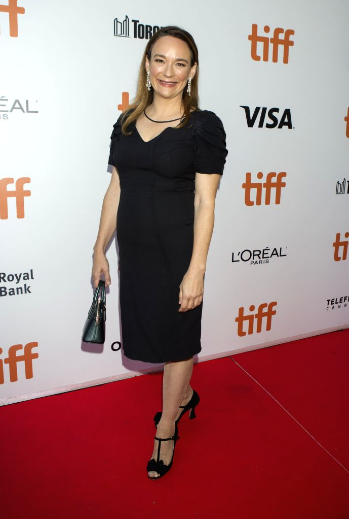 """TORONTO, Sept. 12, 2019 - Director Semi Chellas poses for photos before the Canadian premiere of the film """"American Woman"""" at Roy Thomson Hall during the 2019 Toronto International Film ..."""