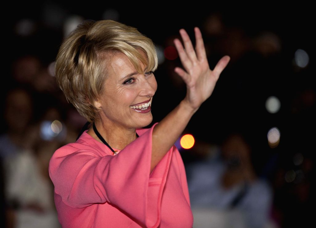 ": TORONTO, Sept. 13, 2013 (Xinhua/IANS)Actress Emma Thompson attends the world premiere of the film ""The Love Punch"" at Roy Thomson Hall during the 38th Toronto International Film Festival in ..."