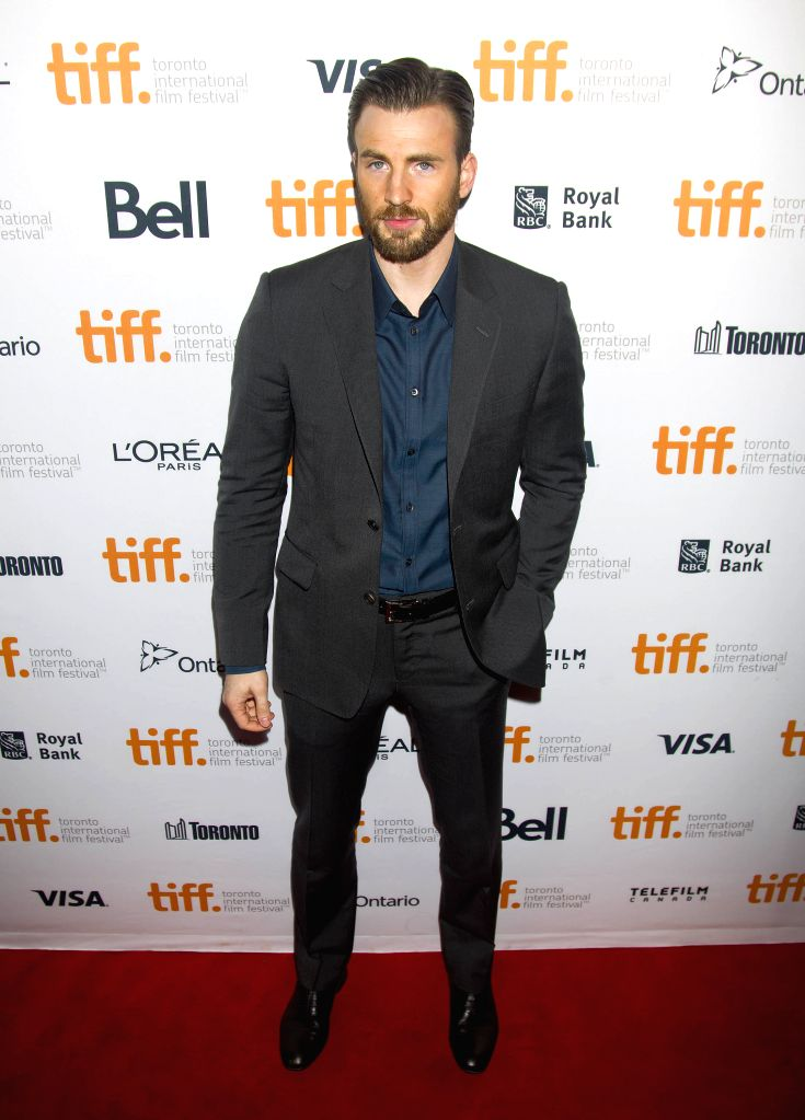 """Director and actor Chris Evans poses for photos before the world premiere of his directorial debut """"Before We Go"""" at the Princess of Wales Theater during - Chris Evans"""