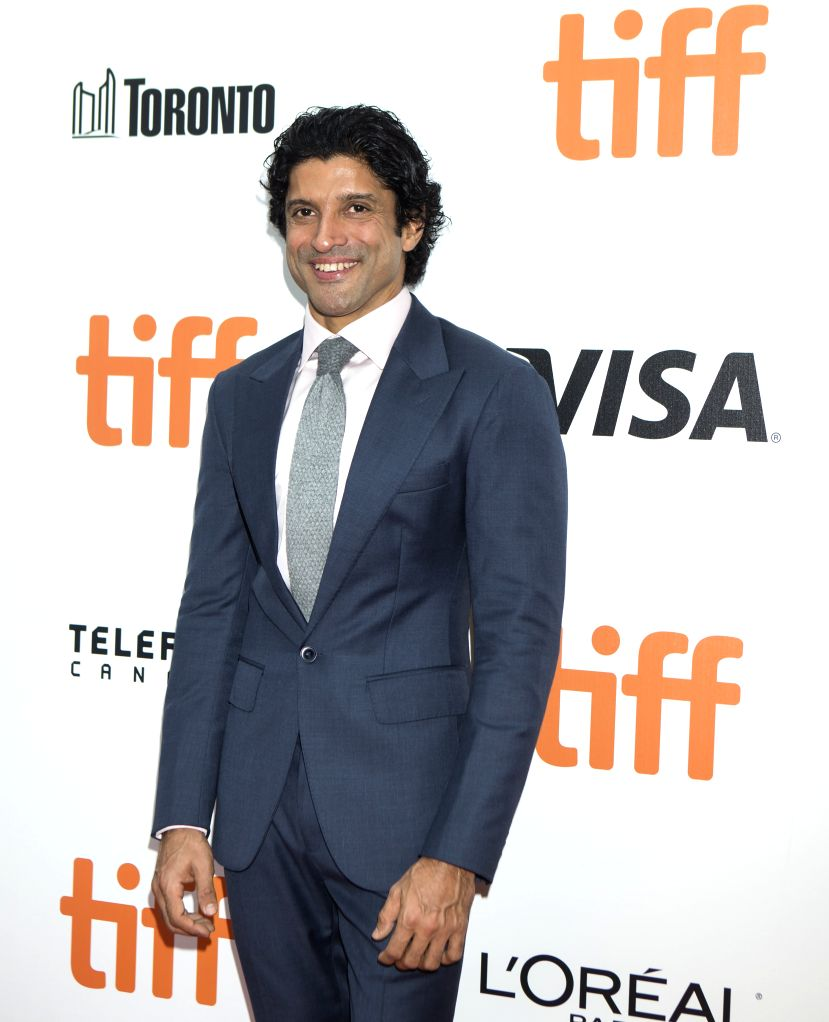 """TORONTO, Sept. 13, 2019 - Actor Farhan Akhtar poses for photos before the world premiere of the film """"The Sky Is Pink"""" at Roy Thomson Hall during the 2019 Toronto International Film ... - Farhan Akhtar"""