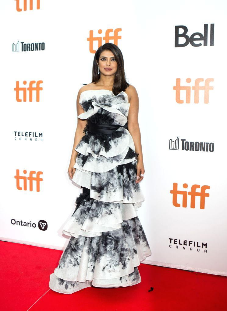 """TORONTO, Sept. 13, 2019 - Actress Priyanka Chopra Jonas poses for photos before the world premiere of the film """"The Sky Is Pink"""" at Roy Thomson Hall during the 2019 Toronto International ... - Priyanka Chopra Jonas"""