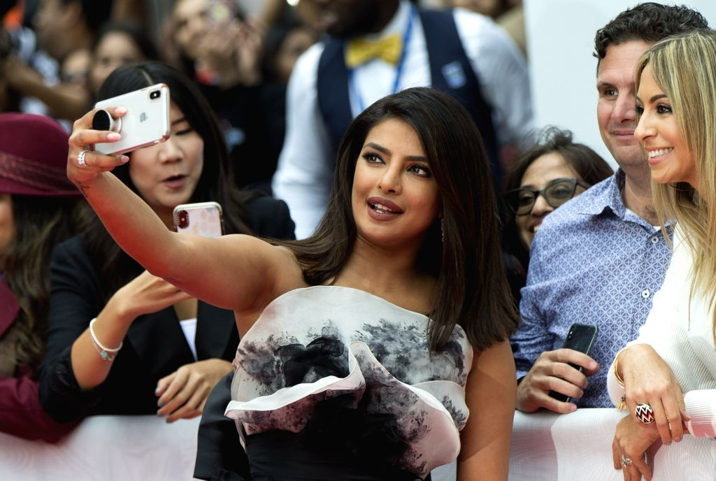 """TORONTO, Sept. 13, 2019 - Actress Priyanka Chopra Jonas (C) takes selfies with fans before the world premiere of the film """"The Sky Is Pink"""" at Roy Thomson Hall during the 2019 Toronto ... - Priyanka Chopra Jonas"""