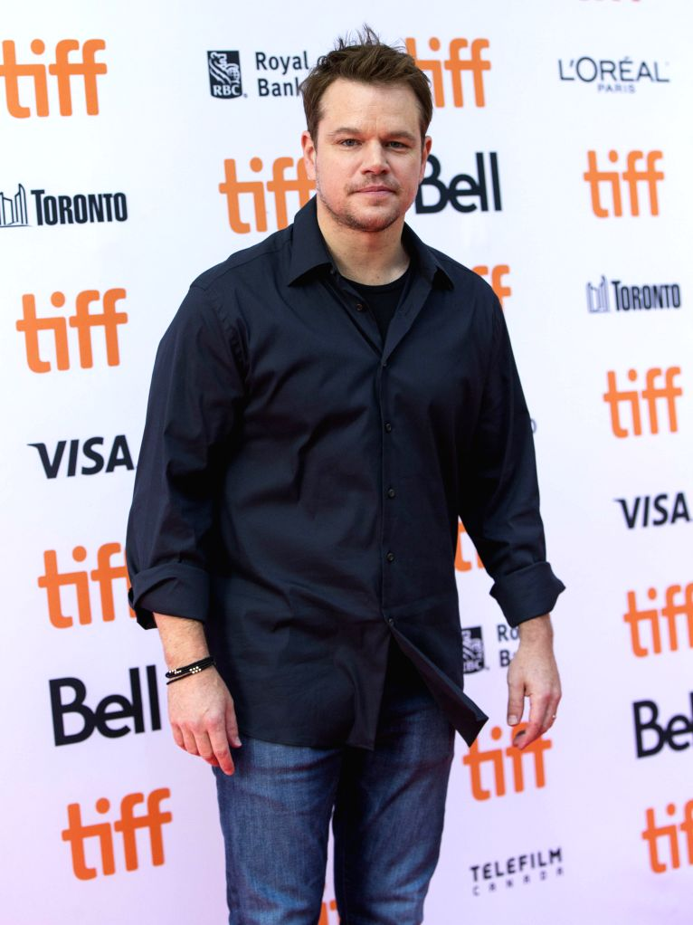 "TORONTO, Sept. 14, 2016 - Producer Matt Damon poses for photos before the international premiere of the film ""Manchester by the Sea"" at the Princess of Wales Theater during the 41st Toronto ..."