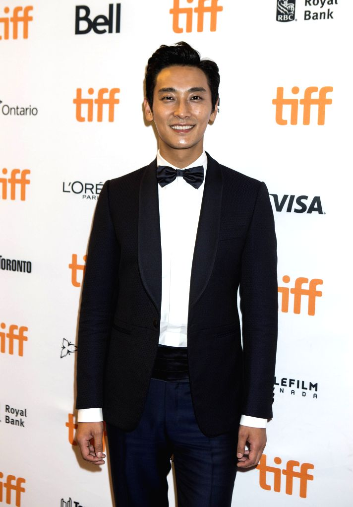 """TORONTO, Sept. 14, 2016 - South Korean actor Ju Ji-hoon attends the world premiere of the film """"Asura:The City of Madness"""" at the Elgin Theater during the 41st Toronto International Film ... - J"""