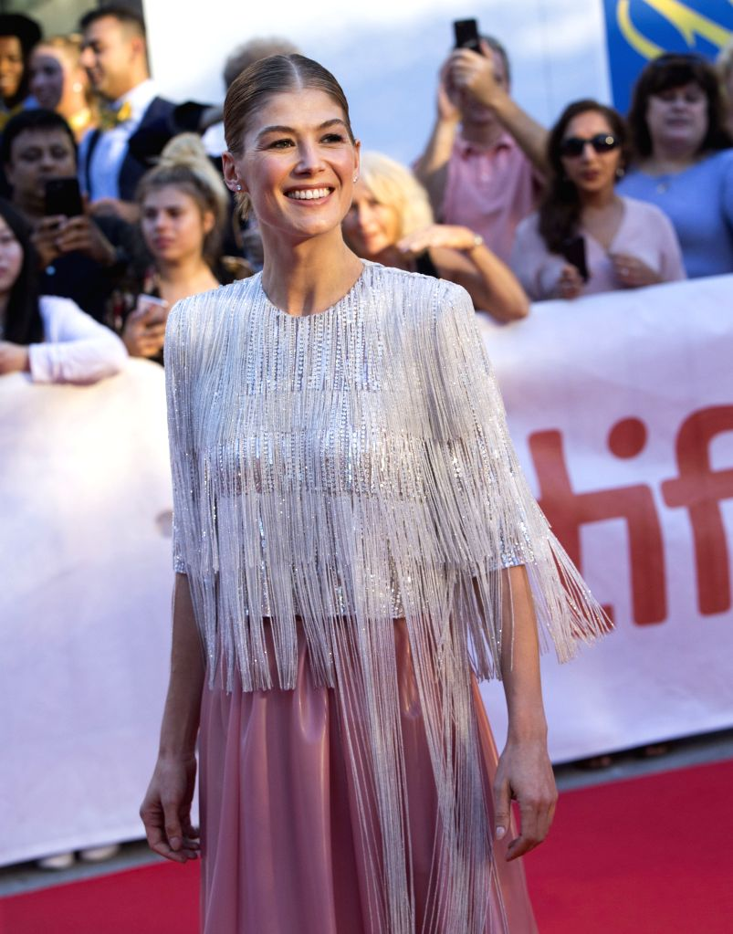"""TORONTO, Sept. 15, 2018 - Actress Rosamund Pike poses for photos before the world premiere of the film """"A Private War"""" at Roy Thomson Hall during the 2018 Toronto International Film ... - Rosamund Pike"""
