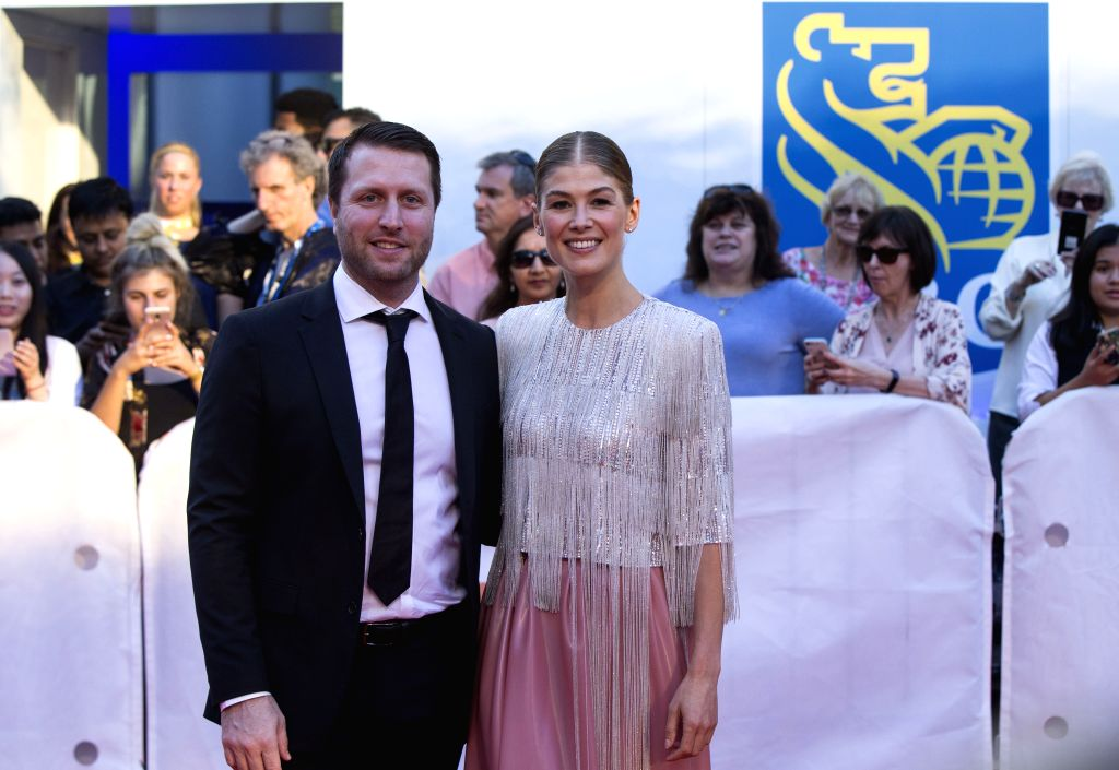 """TORONTO, Sept. 15, 2018 - Actress Rosamund Pike (R) and director Matthew Heineman pose for photos before the world premiere of the film """"A Private War"""" at Roy Thomson Hall during the 2018 ... - Rosamund Pike"""