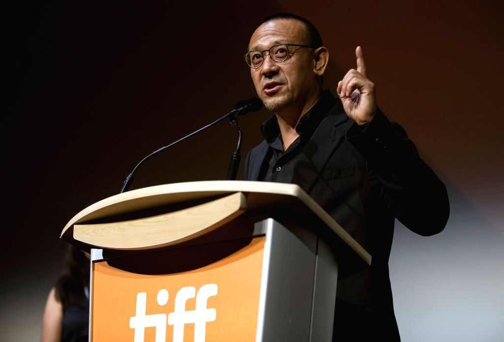 """TORONTO, Sept. 15, 2018 - Director Jiang Wen speaks to spectators before the film """"Hidden Man"""" at Roy Thomson Hall during the 2018 Toronto International Film Festival in Toronto, Canada, ..."""