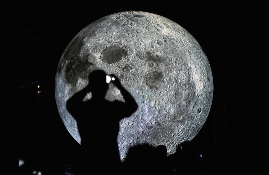 """TORONTO, Sept. 15, 2019 - A man takes photos of the installation of the """"Museum of the Moon"""" in Toronto, Canada, Sept. 14, 2019. Created by renowned British artist Luke Jerram, the ... - Luke Jerram"""