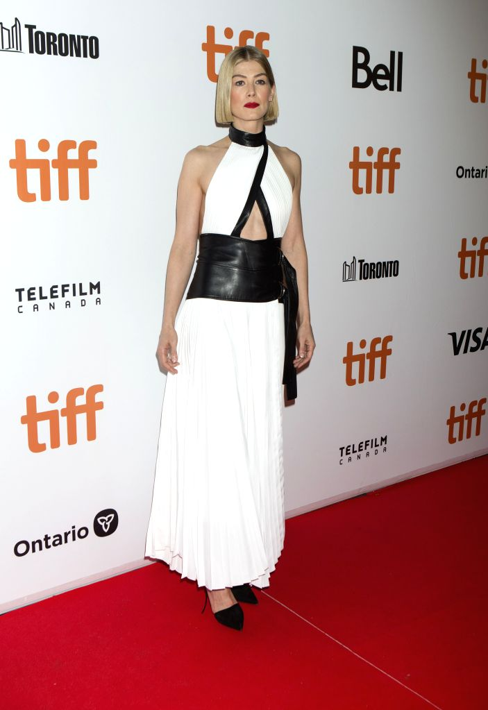 """TORONTO, Sept. 15, 2019 - Actress Rosamund Pike poses for photos before the world premiere of the film """"Radioactive"""" at Roy Thomson Hall during the 2019 Toronto International Film ... - Rosamund Pike"""