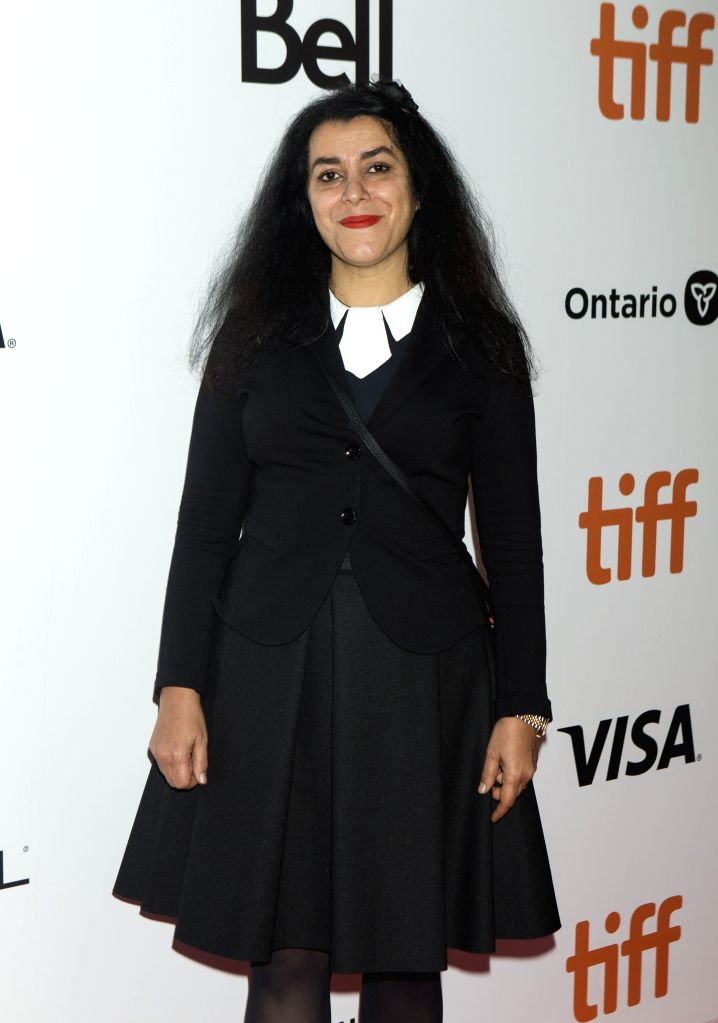 """TORONTO, Sept. 15, 2019 - Director Marjane Satrapi poses for photos before the world premiere of the film """"Radioactive"""" at Roy Thomson Hall during the 2019 Toronto International Film ..."""