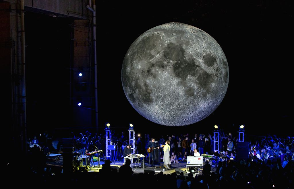 """TORONTO, Sept. 15, 2019 - People watch the installation of the """"Museum of the Moon"""" in Toronto, Canada, Sept. 14, 2019. Created by renowned British artist Luke Jerram, the """"Museum of ... - Luke Jerram"""